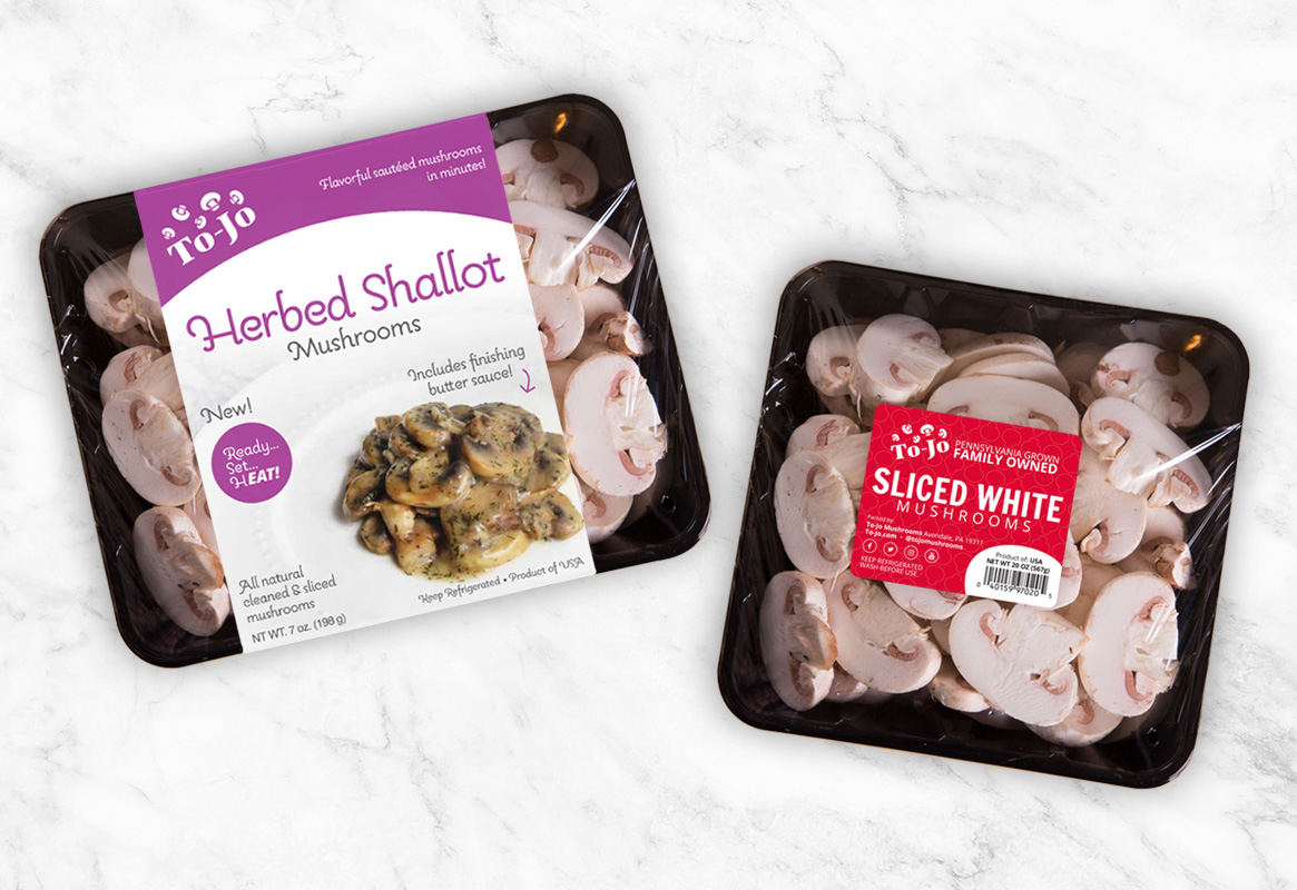 Herbed Shallot Mushrooms and Sliced White Mushrooms packaging on marble table