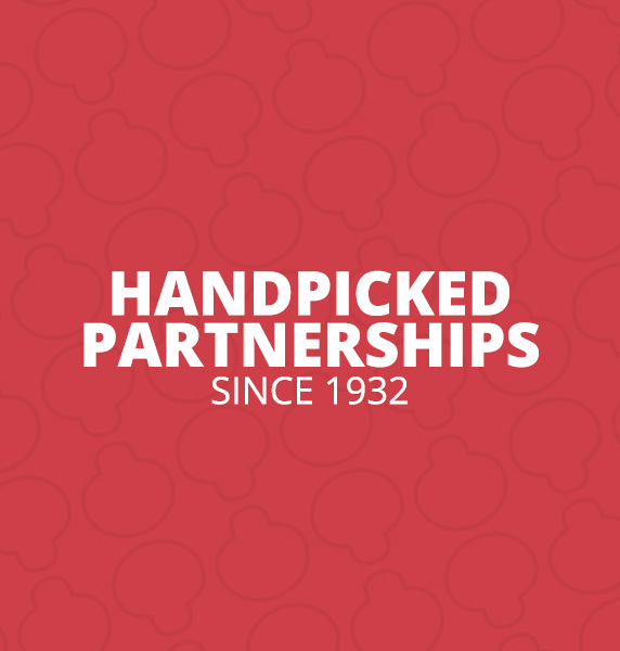 Handpicked Partnerships since 1932 in white letters on red background