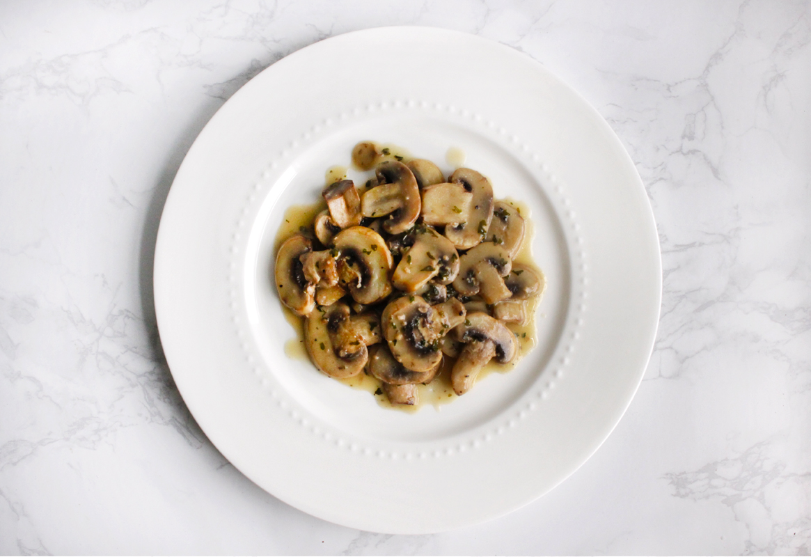 Mushrooms on white plate
