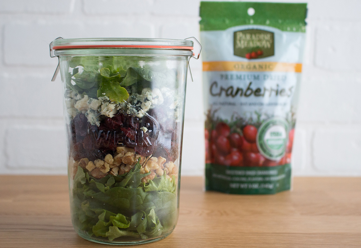 paradise meadow organic dried cranberry bag with salad layered in a weck jar