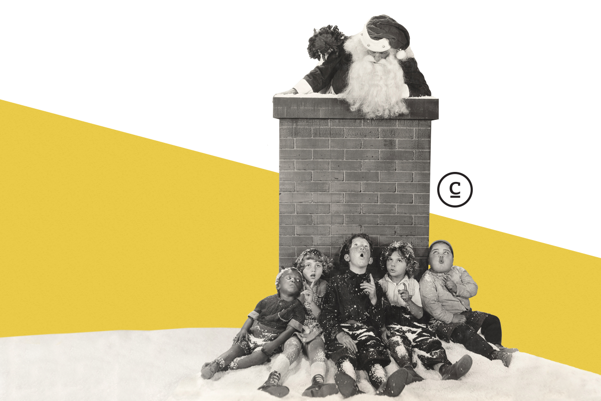 santa popping out of a chimney with surprised children